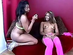 Two cute sexy black lesbians enjoy on bed